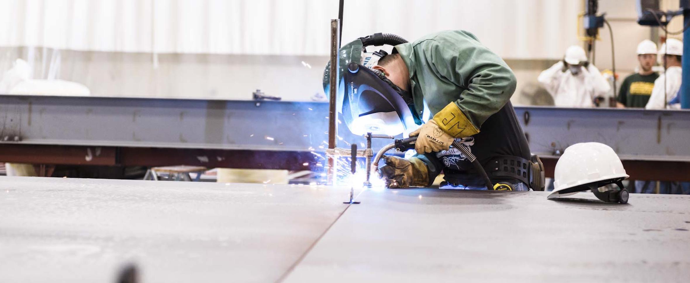 Safety - Welder in protective gear welding steel